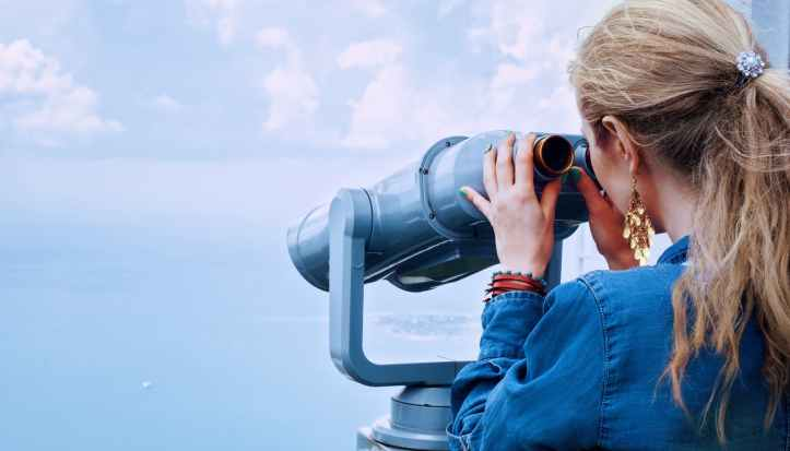 girl-sea-binoculars-vacation-160514.jpeg